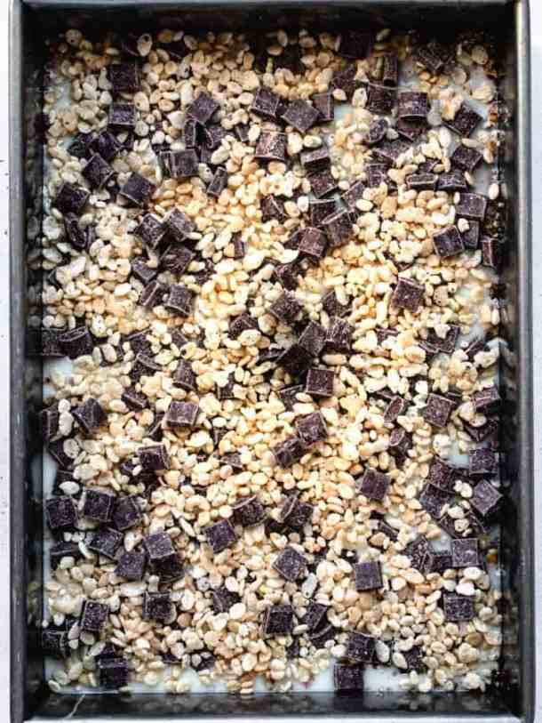 Overhead of layers of cereal snack bars in a pan