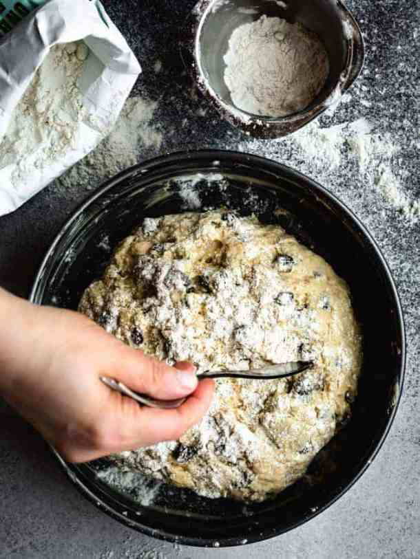 cutting cross into top of Irish soda bread dough with wrong side of a fork
