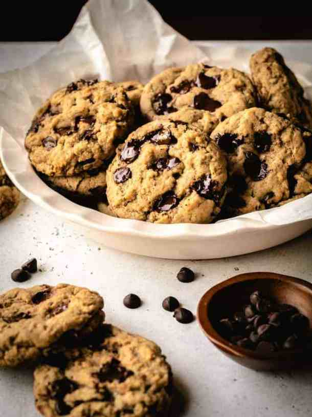 chocolate chip cookies just baked in a white dish