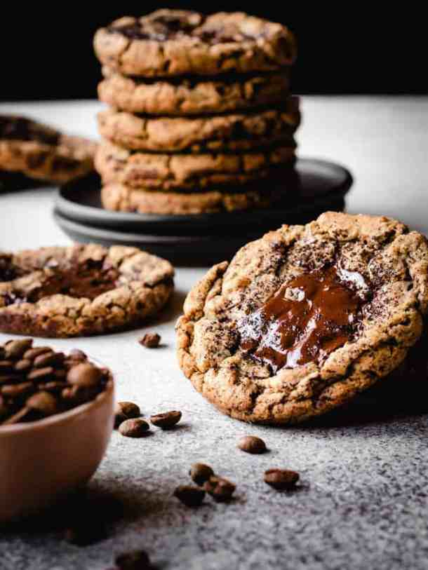 coffee chocolate chunk cookies with coffee beans in a bowl