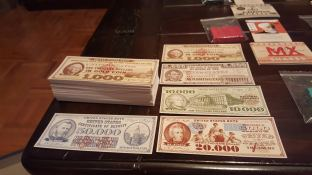 Thick cardstock money in the various denominations.