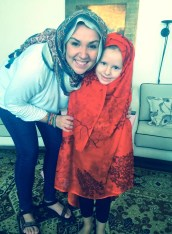 """""""Jamie please fix my scarf!! I want one too."""" The twins entertain themselves with their own headscarves."""