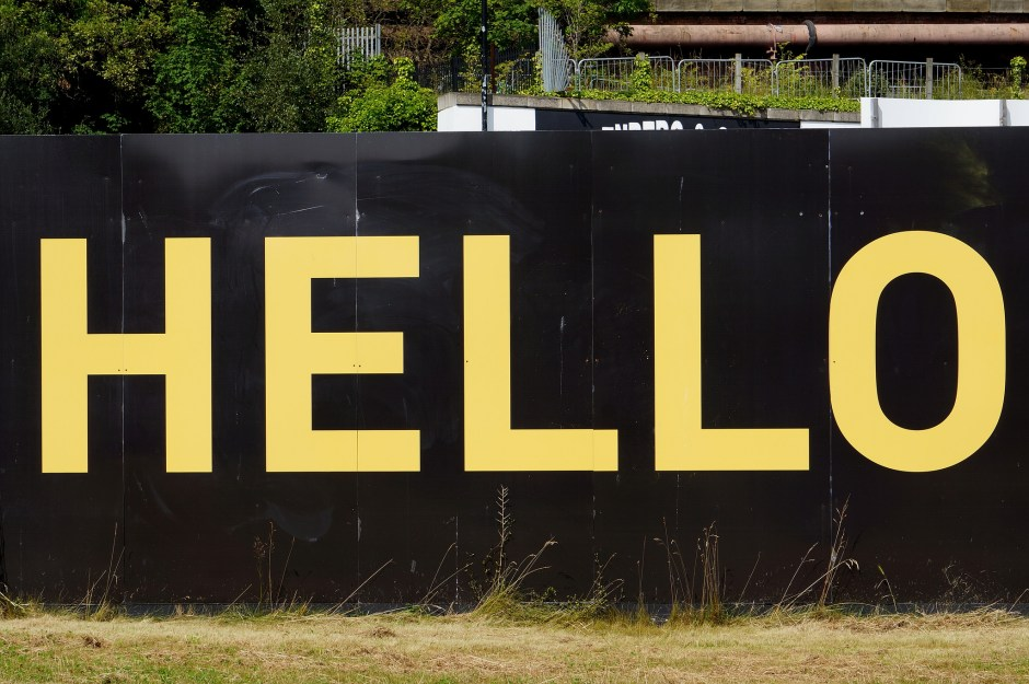"Sign that reads ""hello"" in large yellow text"