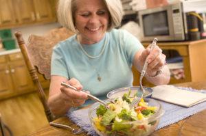 17229-a-woman-eating-a-fresh-salad-pv