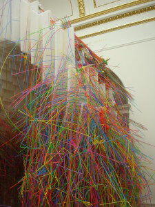Long colourful straws inserted into a plastic honeycomb tunnel