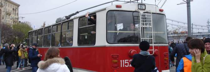 Red and white trolleybus at the trolleybus parade 2015
