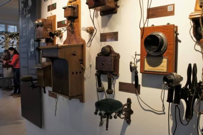 Very early telephones on a wall at the Museum of Telephone History in Moscow