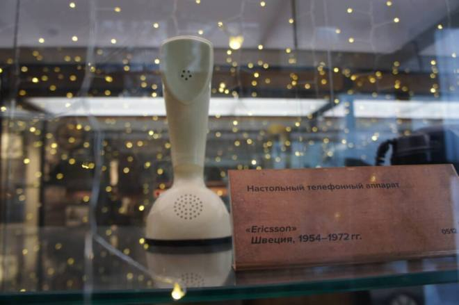 White freestanding Ericsson phone handset used by Gagarin in a glass case. at the Museum of Telephone History Moscow.