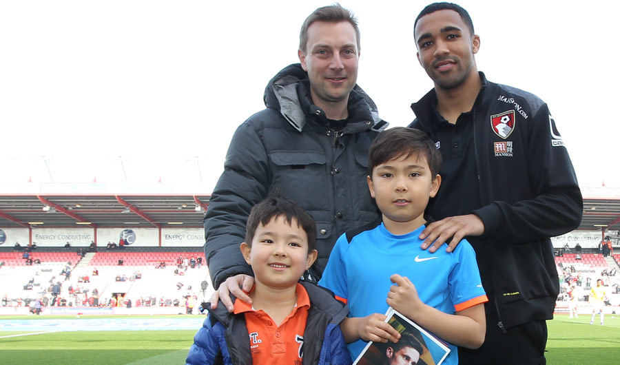 AFCB player Callum Wilson with poster competition winner Richard Kopfli (right) with Richard's dad and brother