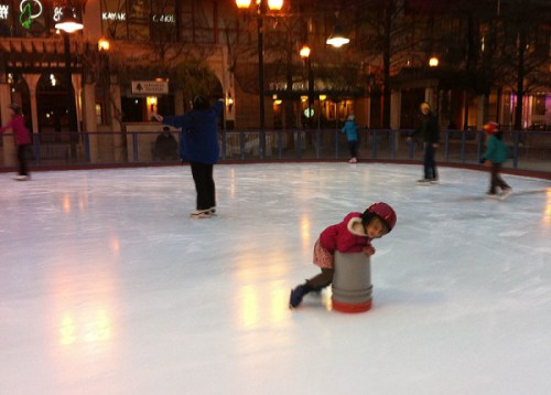 Skating at Pentagon Row last winter -- they provide buckets to help newbies around the rink