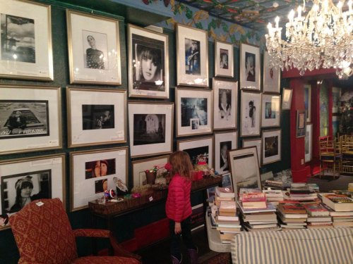 A wall of photos in a downstairs room