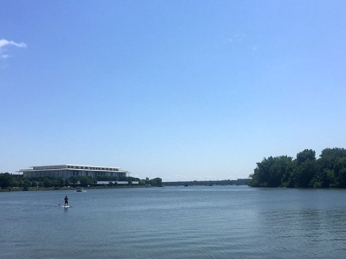 A view of the Kennedy Center, where skateboarding is currently in focus, and a lone paddle boarder enjoying time on the Potomac