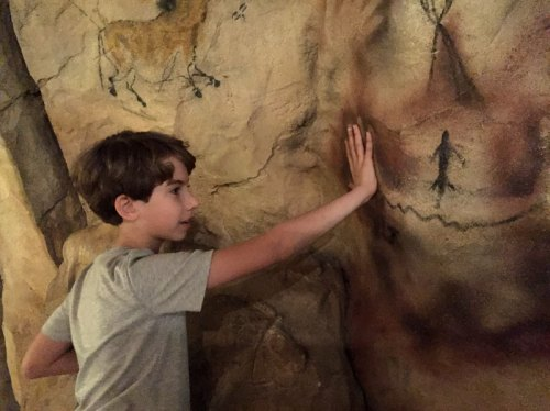 Comparing hand prints in cave dwellings at the Natural History Museum