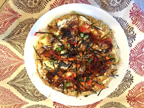 Okonomiyaki is like a Japanese pizza and as tasty as it is interesting