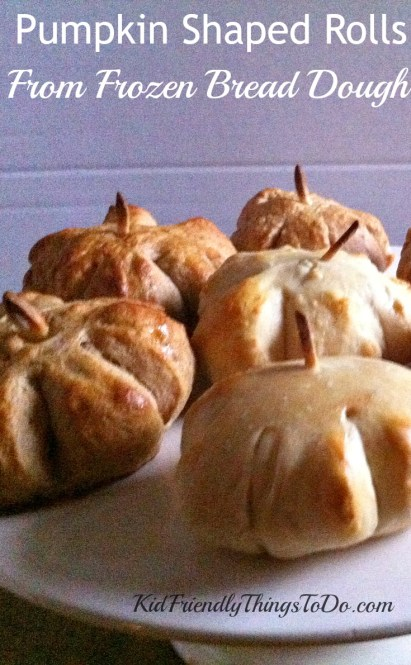 Make Pumpkin Shaped Dinner Rolls with Almond Sliver Stem from Frozen Bread Dough - KidFriendlyThingsToDo.com