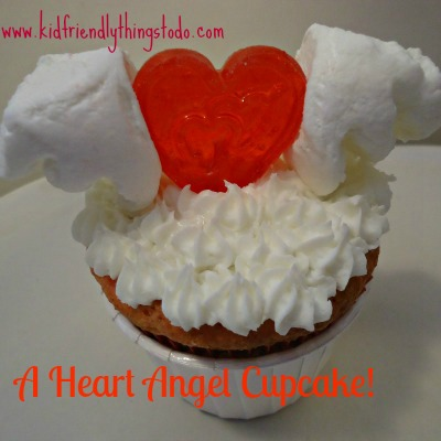 A Flying Heart! All you need to decorate this cupcake are 2 marshmallows, and a heart lollipop!