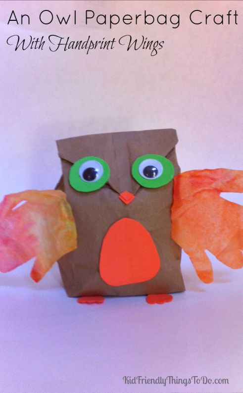 The cutest little owl decoration for fall or Halloween with kids handprints for wings! KidFriendlyThingsToDo.com