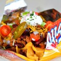 Slow Cooker Frito Pie Recipe with Chili Con Carne - Easy and so delicious. Perfect for game day, tailgating, or family dinner - www.kidfriendlythingstodo.com
