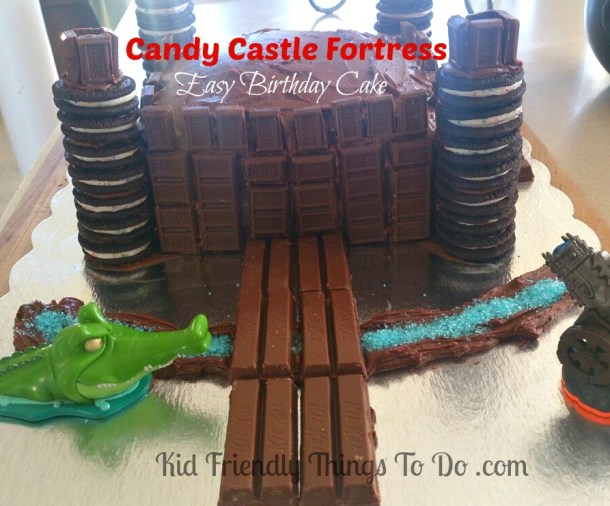 A Cool Candy Fortress Castle Cake decorated with Hershey Bars, Oreo Cookies, and Kit-Kat Bars! This is so simple to make and the kids love this!