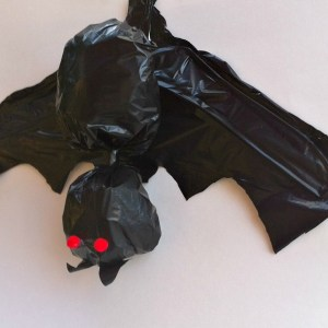 Making A Bat out of Clothes Hangers and Garbage Bags Halloween Craft. We just love these bats hanging in our trees! Cute yard decoration! - KidFriendlyThingsToDo.com