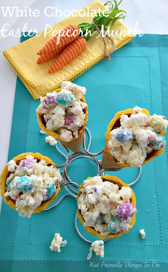 Adorable and Fun! Bunny Bait Munch made from Sea Salt Popcorn with Coconut, Candy and White Chocolate in a fun Chocolate Dipped Waffle Cone - Seriously fun and yummy for Easter or Spring Kid Parties! - KidFriendlyThingsToDo.com