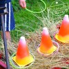 Easy DIY Candy Corn Ring Toss with Glow Necklaces for a Fun Fall, Halloween, or Thanksgiving Game - perfect for kid's school party, harvest parties, or family fun! www.kidfriendlythingstodo.com