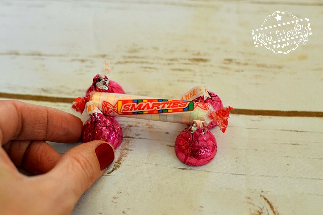 Make a Valentine's Candy Dog for a Fun Kid's Craft and Treat - Easy and Fun to Make! Made from Hershey's Kisses and Smarties Candy. So cute! www.kidfriendlythingstodo.com