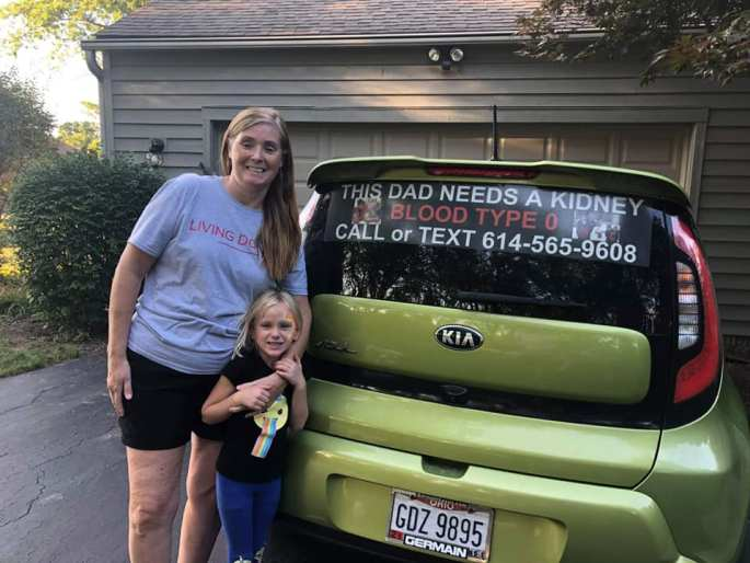 My granddaughter and I just before we remove the sign from my car!
