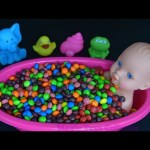 Baby Doll BathTime in Skittles Learn colors  Pretend Play How To bath a baby doll.