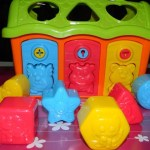 Toys for children. House with surprise animals and kies for playing