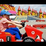 Outdoor playground fun for kids. Minicars, elastic rope, boncy castle ….