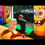 Outdoor playground for kids with inflatable sliders. Funny video