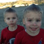 Twins Throw Sand at Each Other
