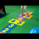 Indoor Playground fun for kids. They playing hopscotch and care for babies.