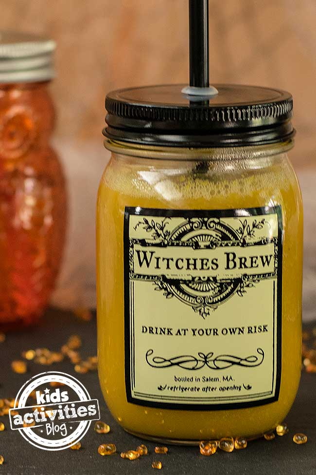 """Jar says """"Witches Brew"""" and is filled with delicious orange Harry Potter Pumpkin Juice"""