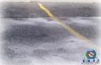 Salt dusting a parking lot