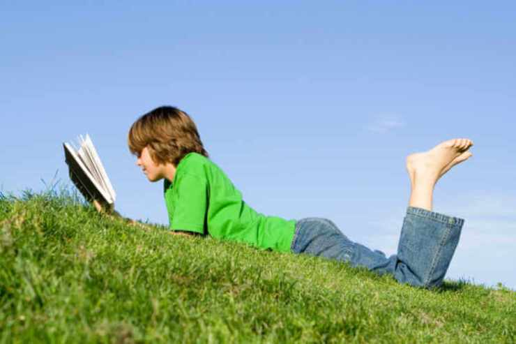 Teen boy reading outside summer-Kids Are A Trip