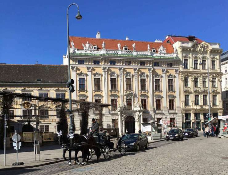 Things to do in Vienna square with carriage-Kids Are A Trip