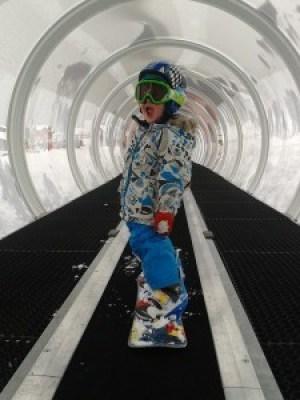 Kid Snowboarding - Travelator