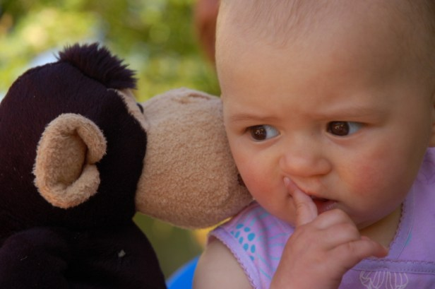 baby-with-cuddly-monkey
