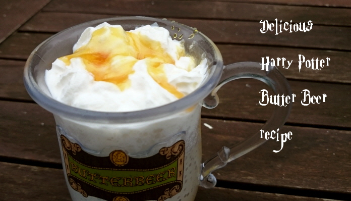 Image of butter-beer-tankard-on-table-with-cream-and-sauce-topping-with-writing