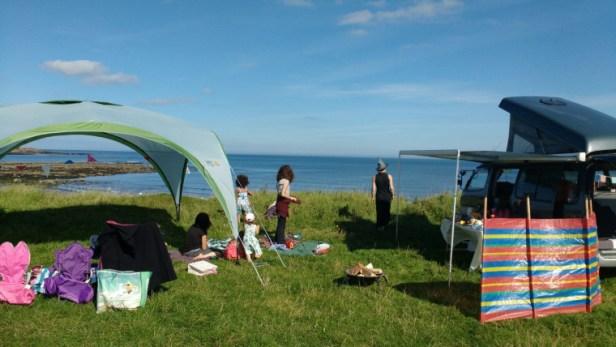 camper-van-and-tent-overlooking-sea