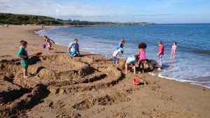 Image of giant-sand-castle-on-beach-hogwarts-castle