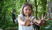 Image of girl-in-woods-showing-dirty-hands
