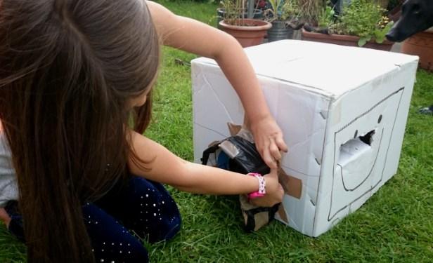 girl-making-a-cardboard-box-hedgehog-house
