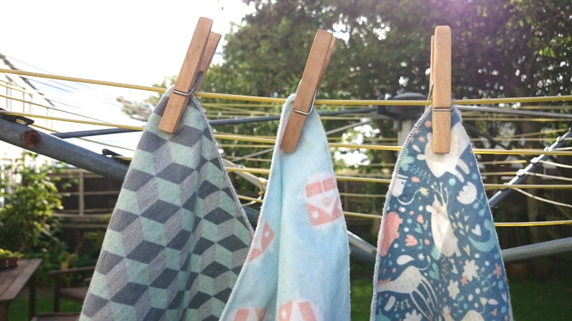 Image of sandwich wraps pegged to outdoor clothes line