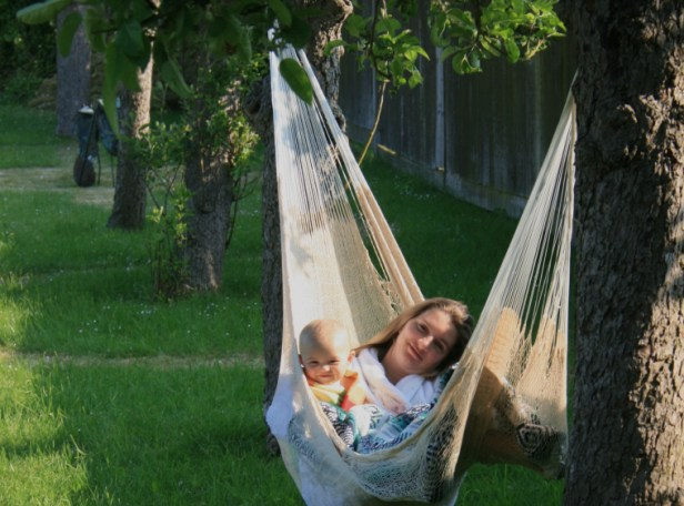 woman-and-child-in-hammock-in-garden