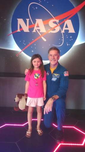 Girl and teddy with Nasa astronaut