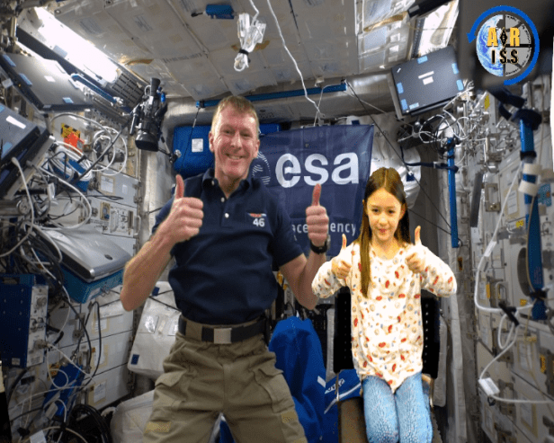 tim-peake-on-the-iss-with-green-screen-addition-of-girl-in-seat-next-to-him