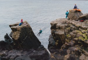 woman-on-tyrolean-traverse-between-cliff-and-sea-stack2